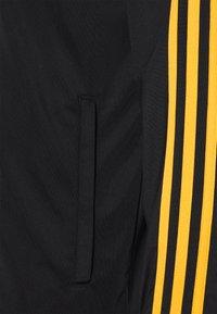 adidas Performance - Träningsjacka - black/active gold - 3