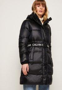 Calvin Klein Jeans - LOGO BELT WAISTED LONG PUFFER - Winter coat - black - 3