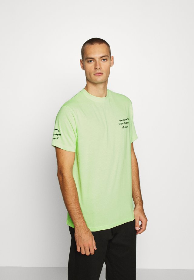 UNISEX SS VIDEO EXCHANGE - Printtipaita - light green