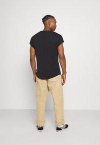 YOURTURN - UNISEX - Basic T-shirt - black - 2