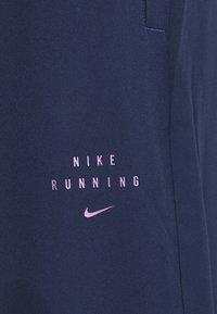 Nike Performance - Pantalones deportivos - midnight navy/black - 6