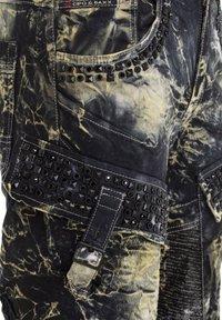 Cipo & Baxx - COOLER WASCHUNG UND ZIERNÄHTEN - Straight leg jeans - khaki - 8
