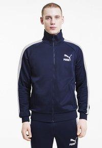 Puma - ICONIC  - Training jacket - peacoat - 0