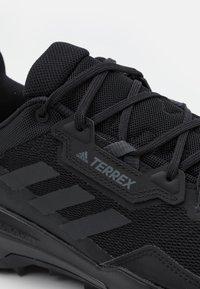 adidas Performance - TERREX AX4 HIKING TECHNICAL PRIMEGREEN SHOES MID - Obuwie hikingowe - core black/carbon/grey four - 5