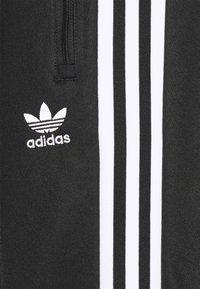 adidas Originals - BECKENBAUER UNISEX - Tracksuit bottoms - black - 2