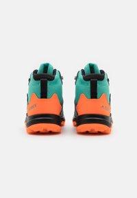 adidas Performance - TERREX MID GTX UNISEX - Hiking shoes - acid mint/core black/screaming orange - 2