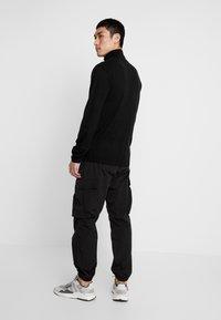 YOURTURN - Cargo trousers - black - 2
