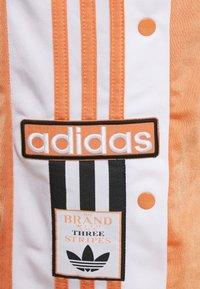 adidas Originals - ADIBREAK - Tracksuit bottoms - hazy copper - 5