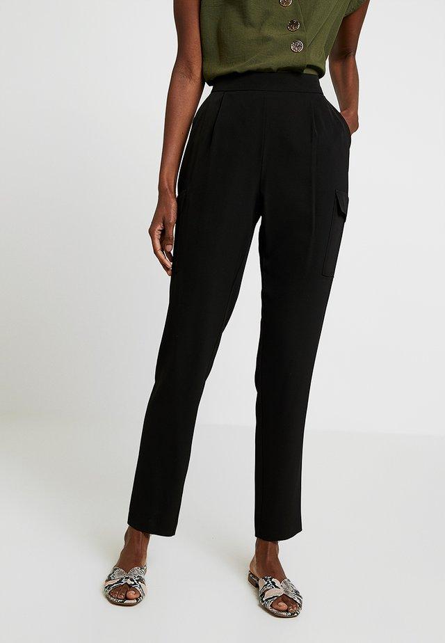UTILITY HENNA - Trousers - black