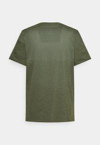Nike Performance - BURNOUT - Print T-shirt - rough green/jade smoke/black - 1