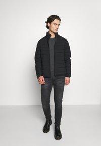 Abercrombie & Fitch - PUFFER JACKET - Light jacket - black - 1