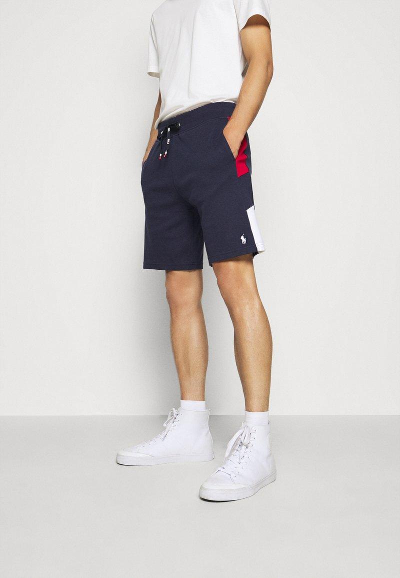 Polo Ralph Lauren - Tracksuit bottoms - cruise navy/multi