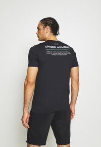 Under Armour - BOXED ALL ATHLETES - Print T-shirt - black - 2