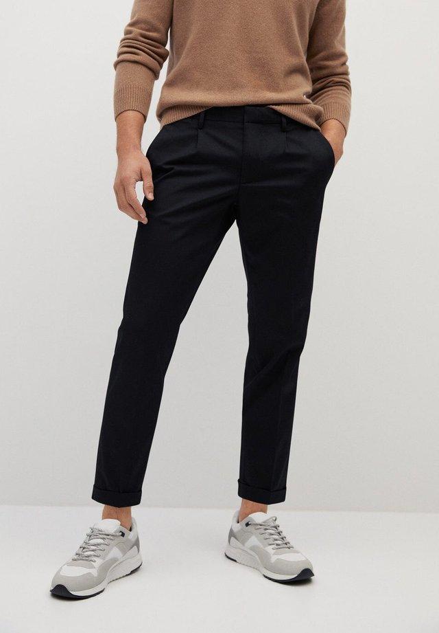 BRISTOL - Trousers - black