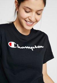 Champion - CREWNECK  - Print T-shirt - black - 3