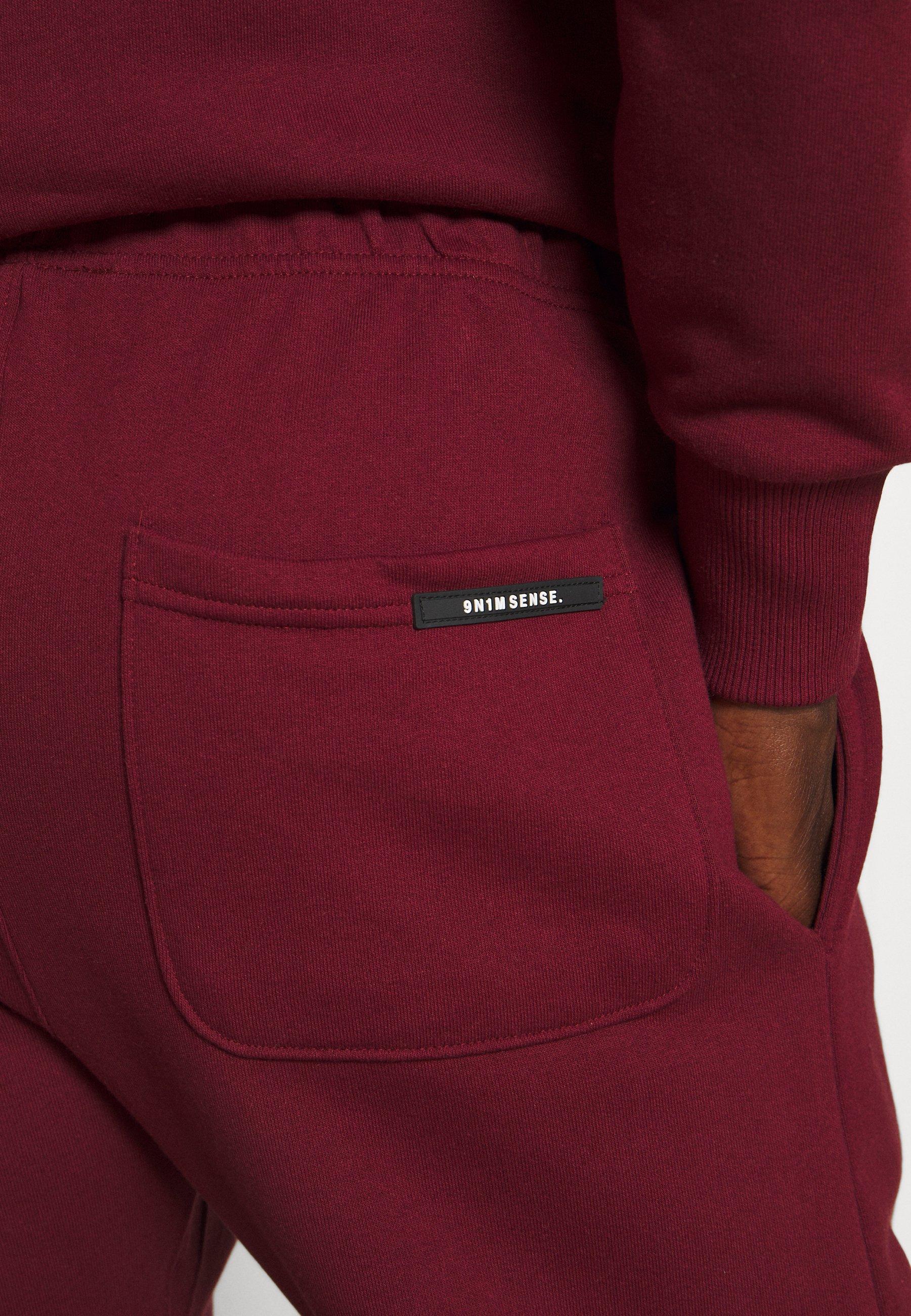 Women LOGO UNISEX - Tracksuit bottoms