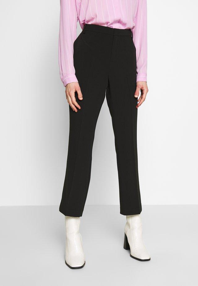 BIRDIE CROPPED - Trousers - black