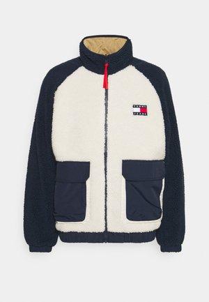 REVERSIBLE SHERPA JACKET - Light jacket - twilight navy/white