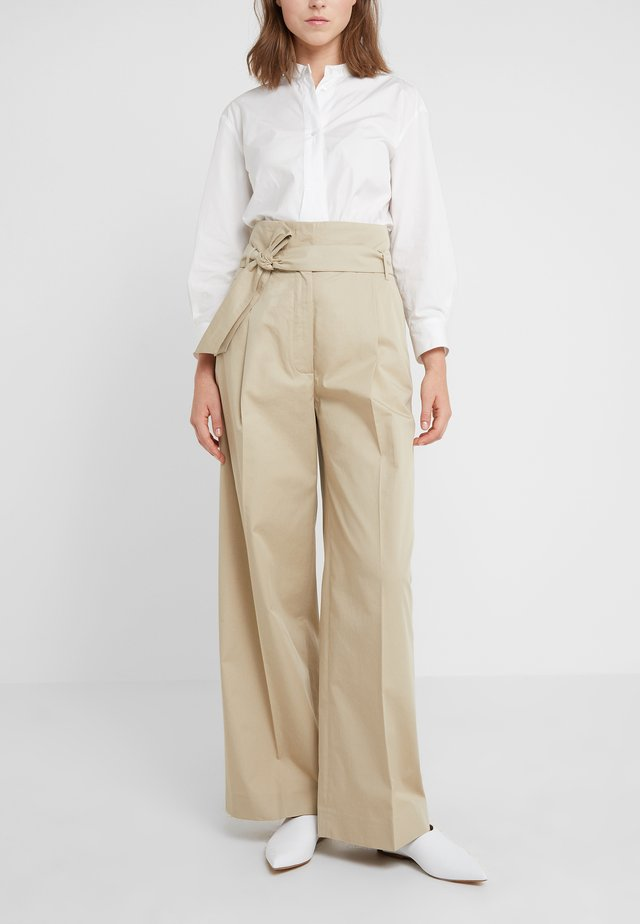 HOLIDAY - Trousers - beige