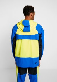 Nike Sportswear - RE-ISSUE - Windbreakers - dynamic yellow/game royal/black - 2