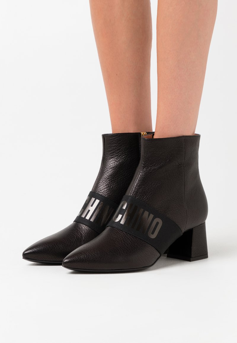 MOSCHINO - Ankle boots - nero
