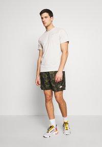 Nike Sportswear - FLOW  - Shorts - legion green/black/treeline - 1