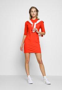 J.LINDEBERG - SAHRA LUX SCULPT - Sportovní šaty - tomato red - 1
