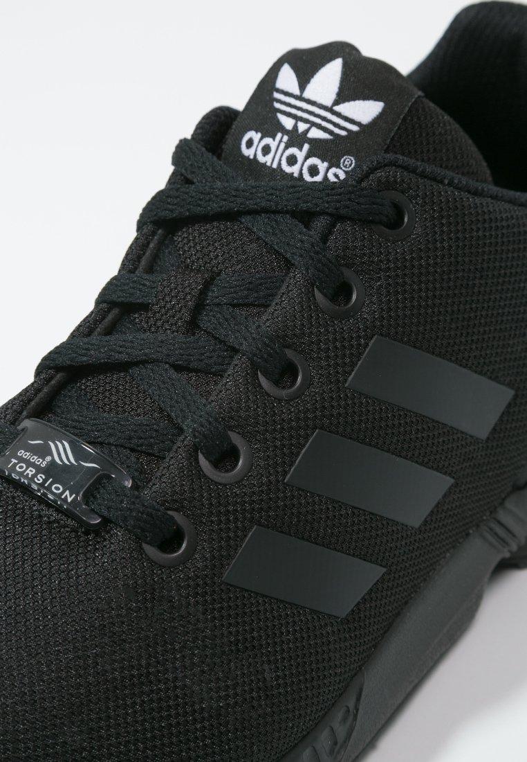 Pirata cubo violación  adidas Originals ZX FLUX - Trainers - core black/black - Zalando.co.uk