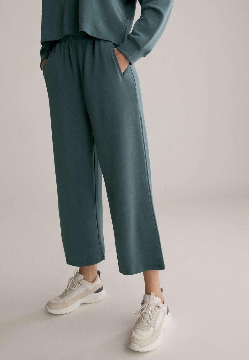OYSHO - Trousers - green