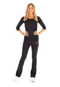 Winshape - BCHWL102 HIGH WAIST TIGHTS - Leggings - black - 0