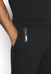 Puma - NU TILITY PANTS - Tracksuit bottoms - black - 5