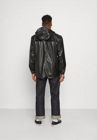 Rains - JACKET UNISEX - Impermeable - shiny black - 2