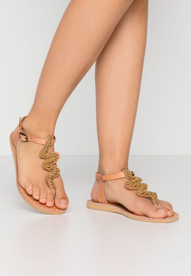 ZIGGY FLAT - T-bar sandals - brown/metal gold