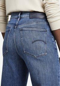 G-Star - DECK ULTRA HIGH WIDE LEG - Flared Jeans - faded santorini - 2