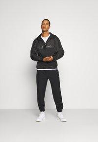 Ellesse - STOREO - Pantalones deportivos - black - 1