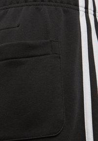 adidas Performance - MUST HAVES 3-STRIPES SHORTS - Sports shorts - black - 3