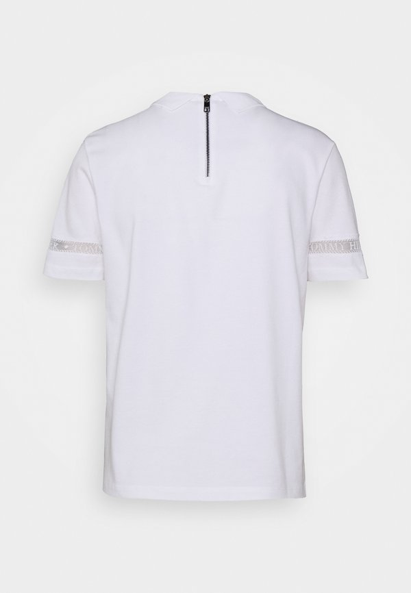 Tommy Hilfiger COOL VERA RELAXED - Koszulka polo - white Kolor jednolity Odzież Damska ZPXM PW 5