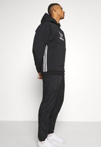 adidas Originals - HOODY UNISEX - Light jacket - black - 3