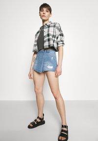 ONLY - ONLTEXAS LIFE - Denim skirt - light blue denim - 3
