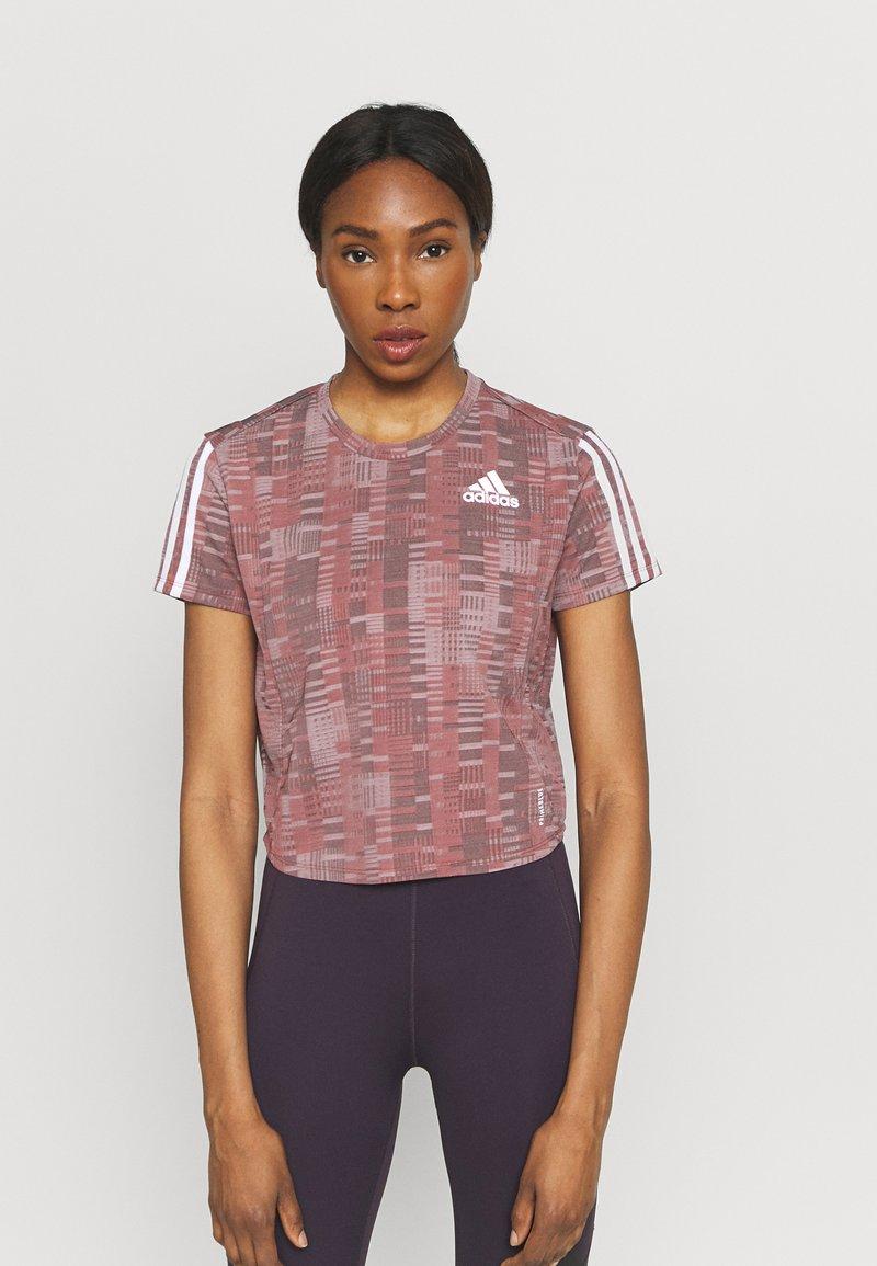 adidas Performance - TEE - Camiseta estampada - scarlet/white