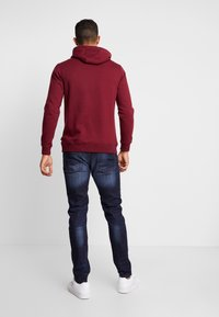 Burton Menswear London - RINSE TRIM - Slim fit jeans - dark blue - 2