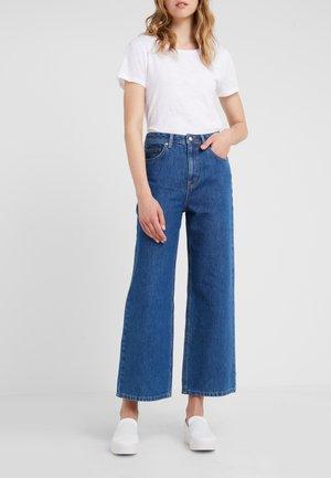 KIRI - Bootcut jeans - medium blue