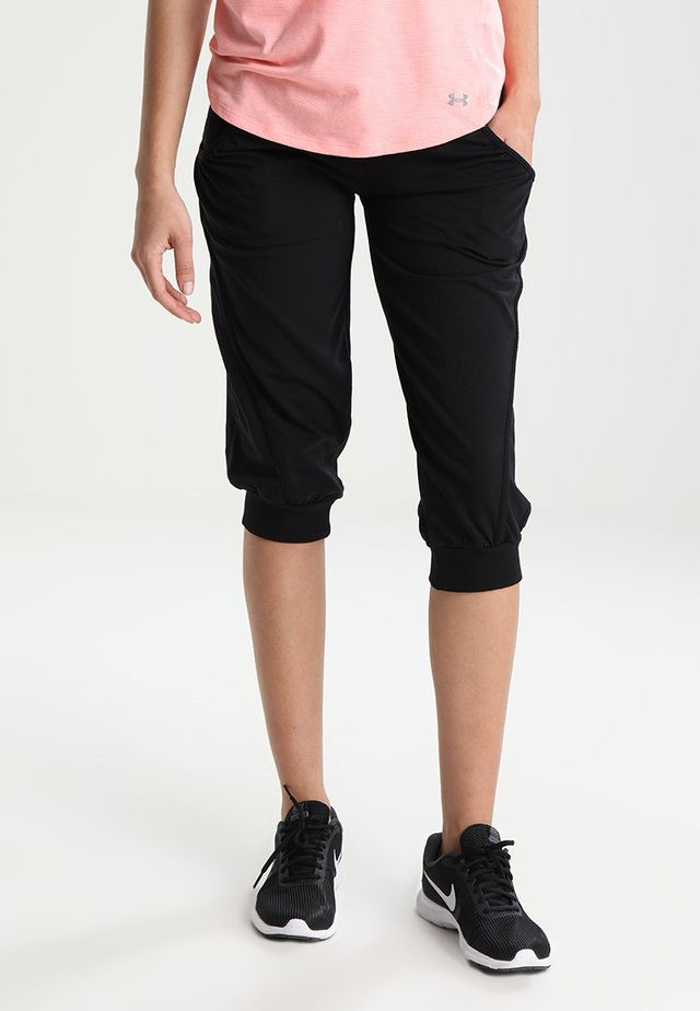 MAGGY - 3/4 sports trousers - black