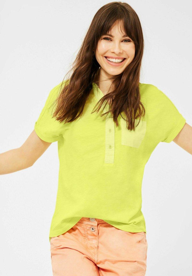 Cecil - Polo shirt - gelb