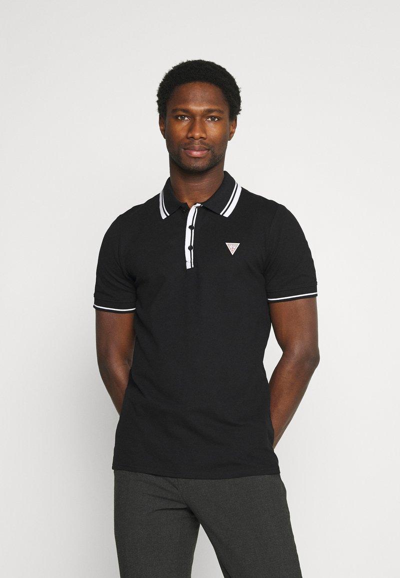 Guess - SCOTT - Polo shirt - jet black