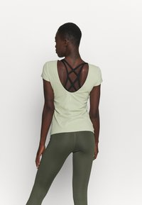 Nike Performance - THE YOGA LUXE - T-shirts - celadon/olive aura - 2