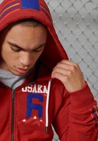 Superdry - Zip-up hoodie - rouge red - 1