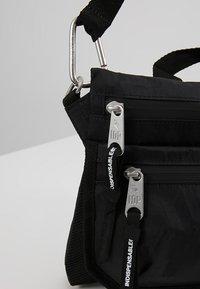 Indispensable - SACOCHE  - Across body bag - black - 5