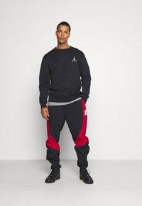 Jordan - Tracksuit bottoms - black/gym red - 1