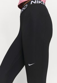 Nike Performance - Leggings - black - 4